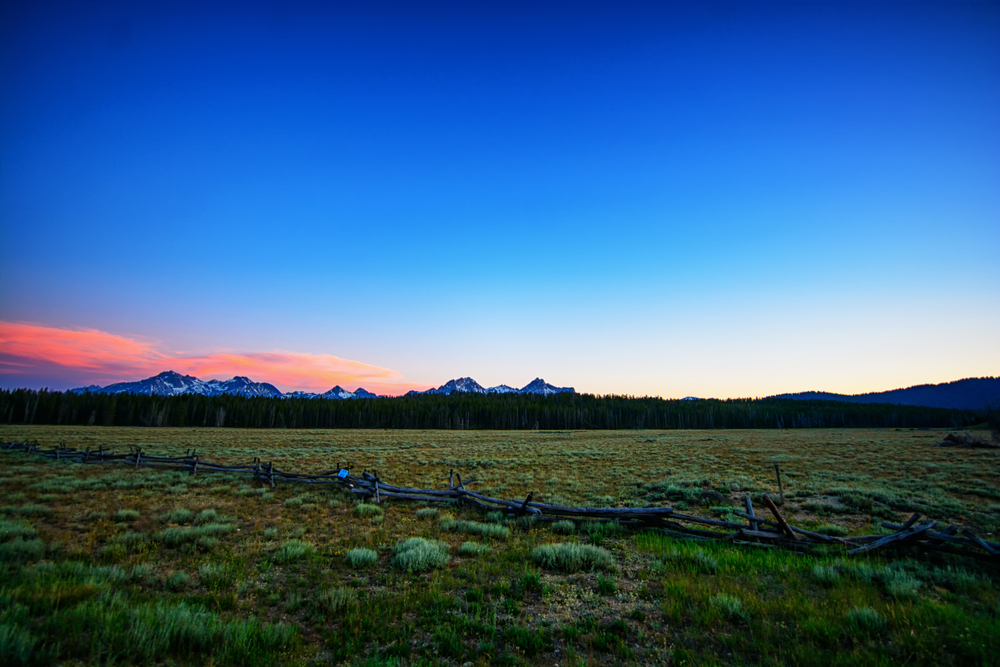 7/1 Photo: After a late start, my brother and I headed up to the Sawtooth Mountain range in Stanley ID (about a 3hr drive from Boise). WOW, one heck of a view! This was at about 10pm, after driving around until 12:30am, we finally crashed in his car in the trailhead parking lot. 4th of July weekend is NOT the weekend to roll the dice with campsite availability.