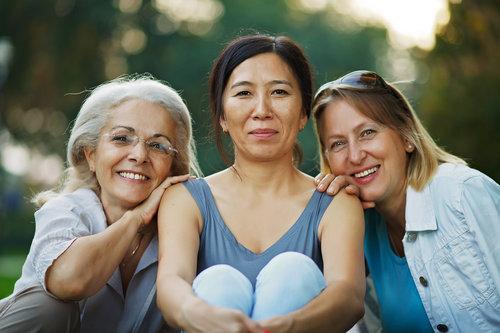 Three smiling mid-life Maga woman.