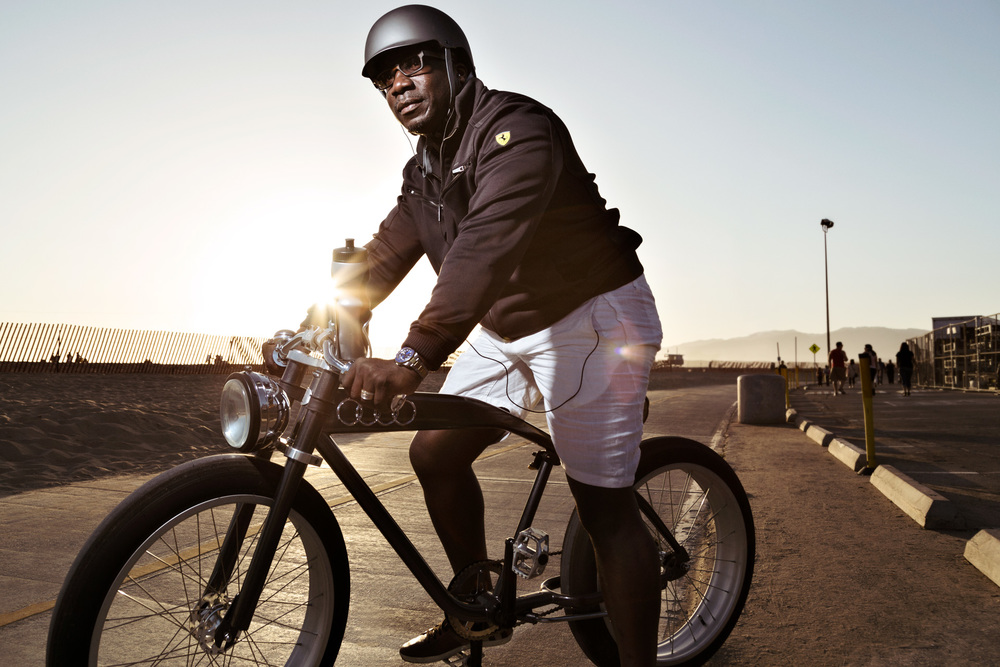 Micah riding his Audi bike with a Ferrari jacket in Santa Monica