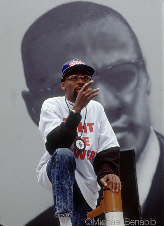 Director Spike Lee with Malcolm X backdrop
