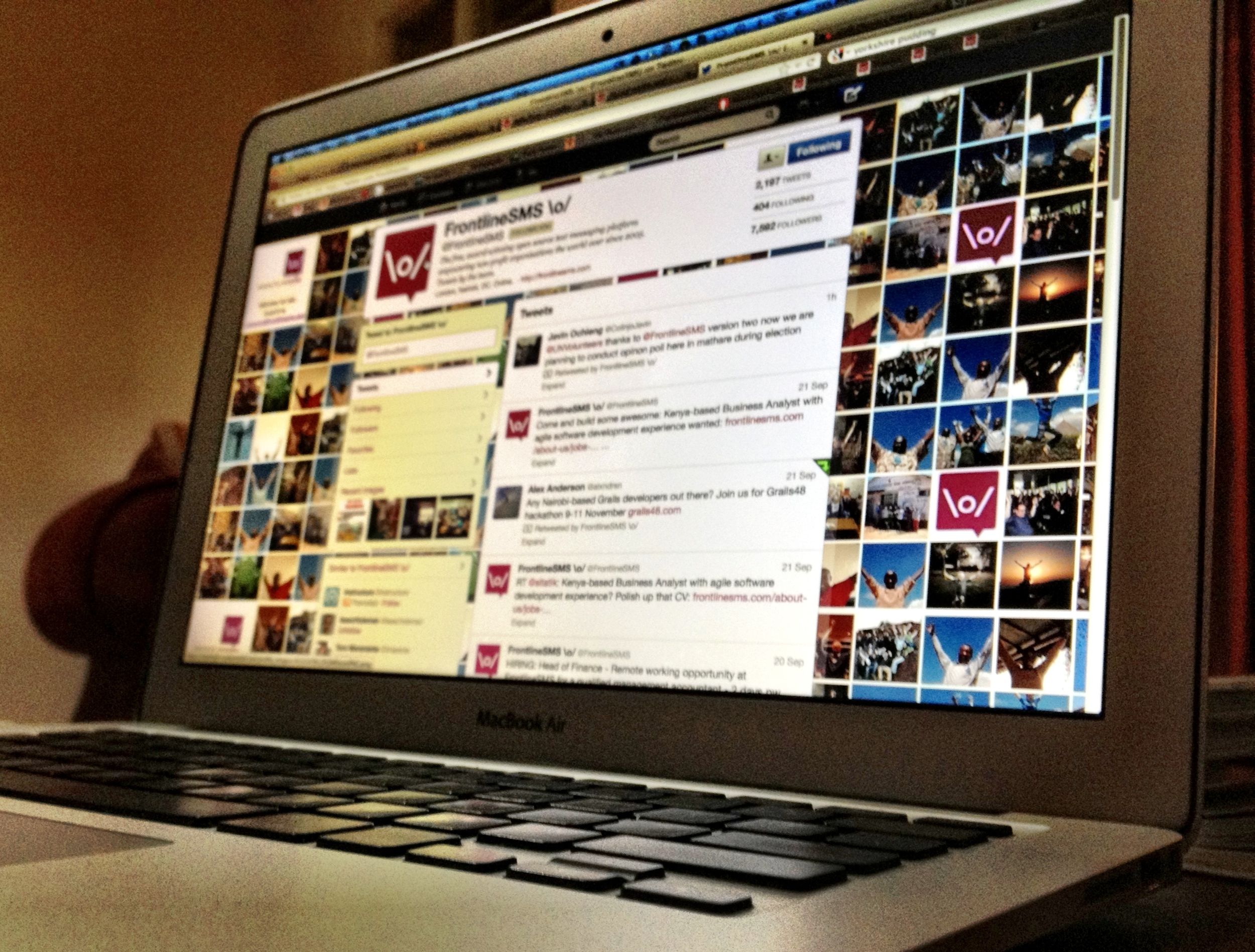 Photo of MacBook Air displaying the FrontlineSMS Twitter page