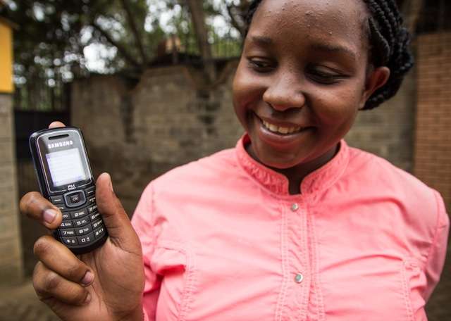 Participant providing her SMS invitation to a study (Photo credit: Kelly Ranck)