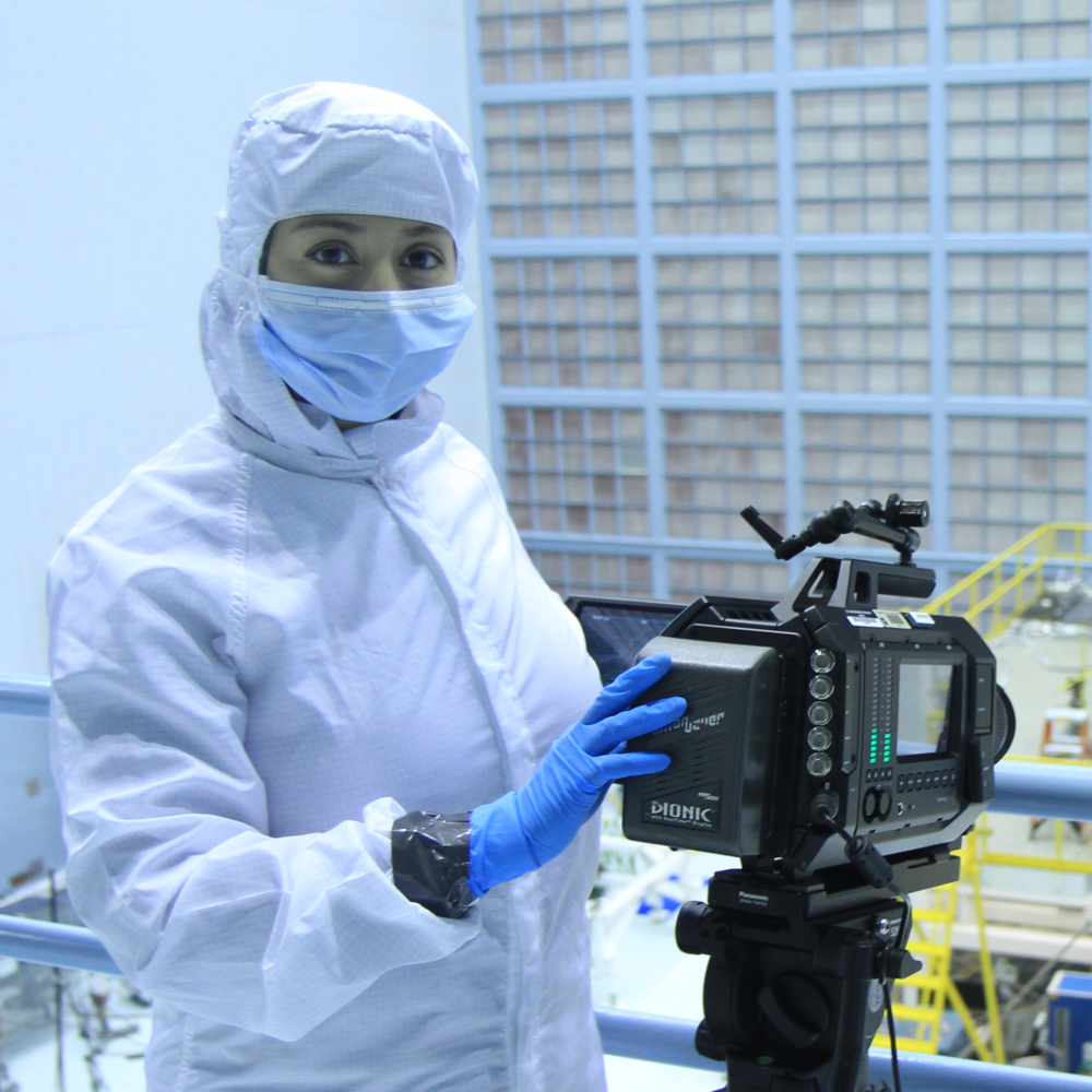 NASA Cinematographer Nasreen Alkhateeb filming in the NASA Clean Room with a Black Magic 4K camera