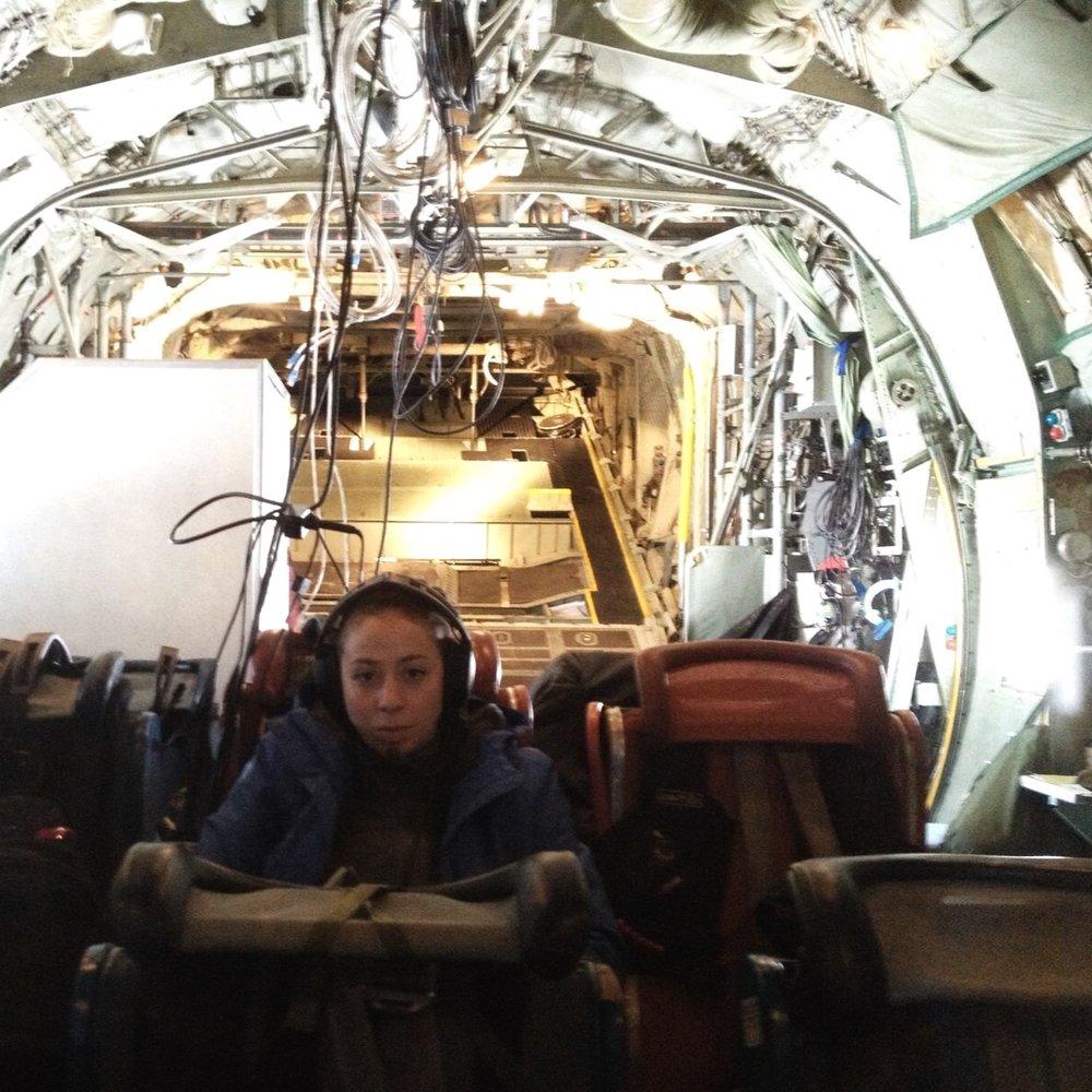 Director Nasreen Alkhateeb aboard C130 in Arctic