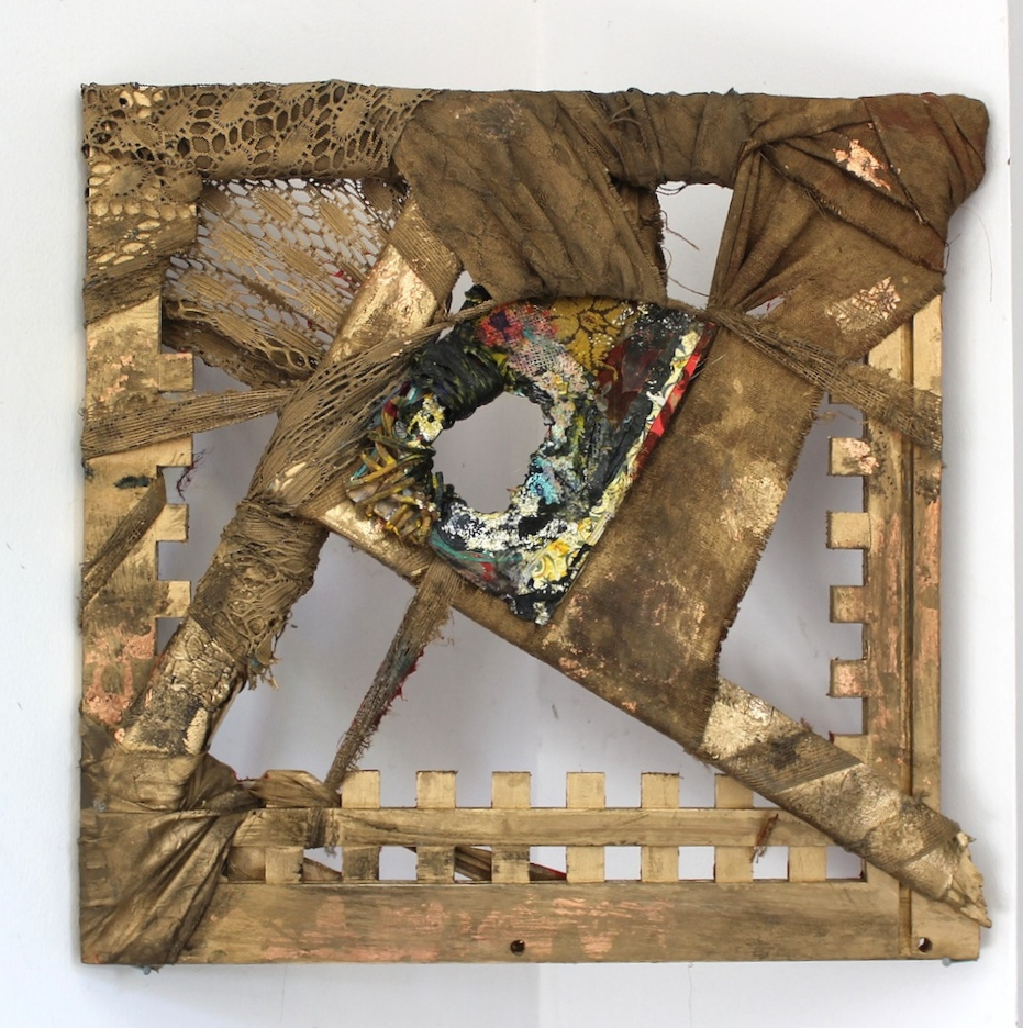 "2012,  Crowe's Toe   12""x12"". Found frame from John Crowe's MassArt office, spray paint, gold lead, lace, upholstery, wallpaper, leather rope."