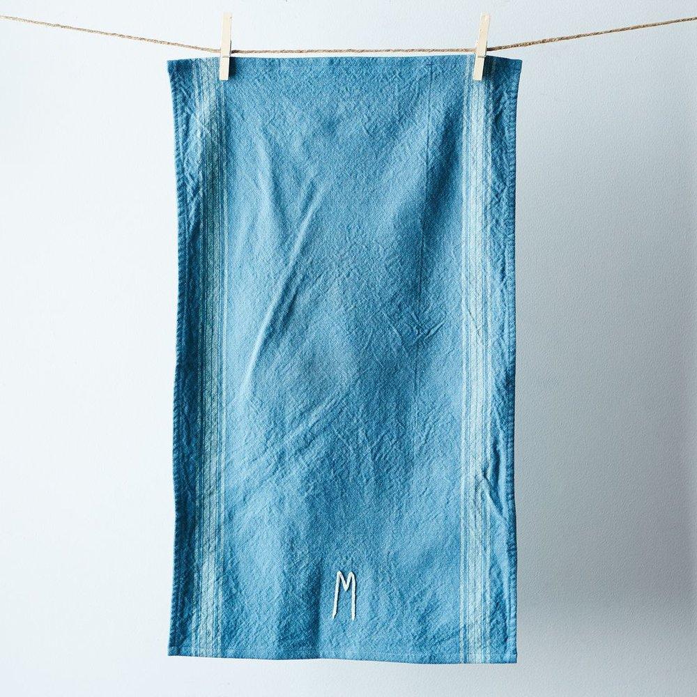 fb7fbffa-a0f6-11e5-a190-0ef7535729df--a-good-home_monogrammed-tea-towel_dusty-blue_provisions_mark_weinberg_19-09-14_1122_SILO.jpg