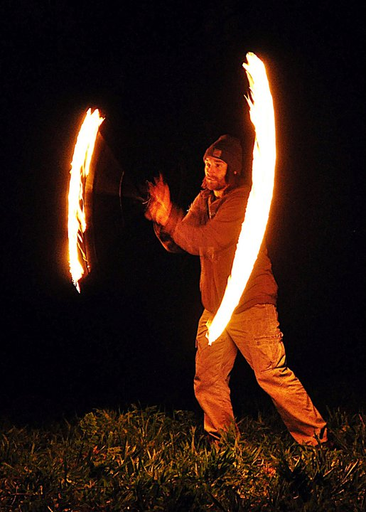 Fire spinning at a community garden potluck