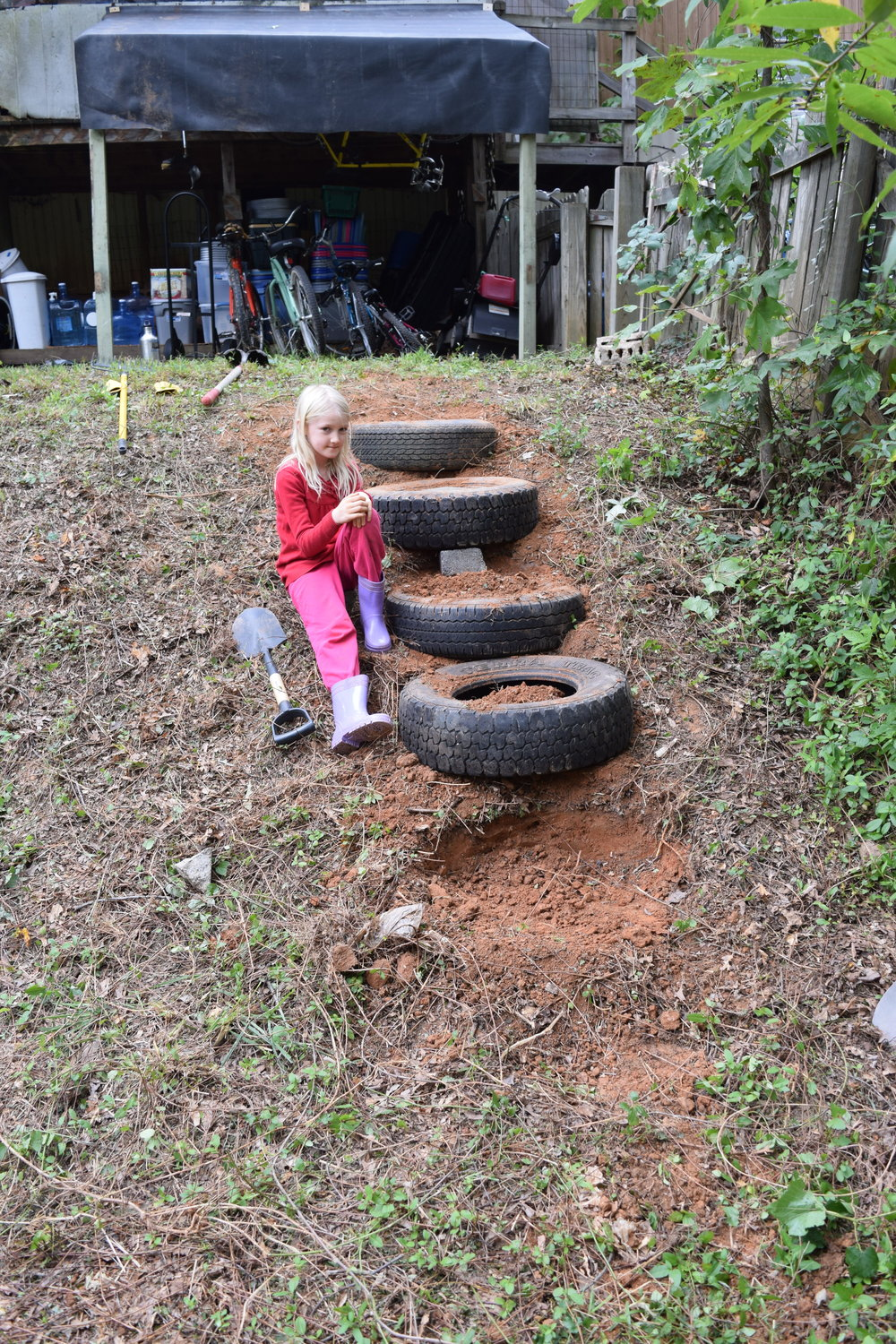 - Gaia helping me build some tire stairs down to the fire pit