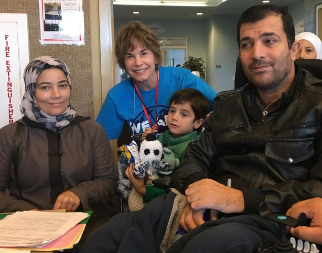 Cheryl with clients at Refugee Adjustment Day