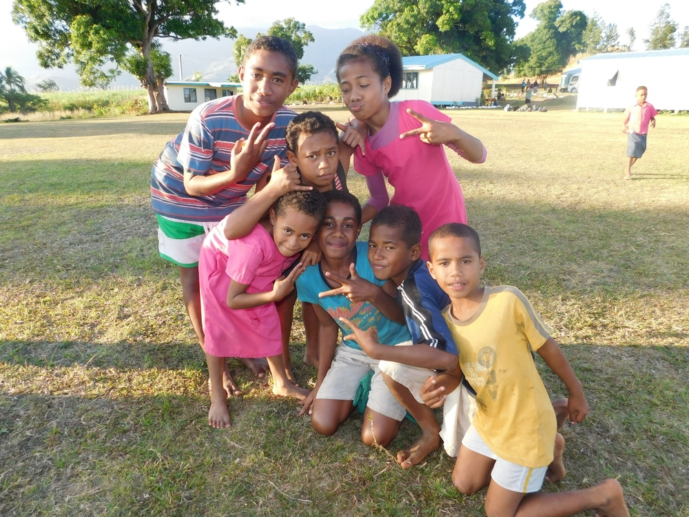 Students posing for a photo on outreach trip