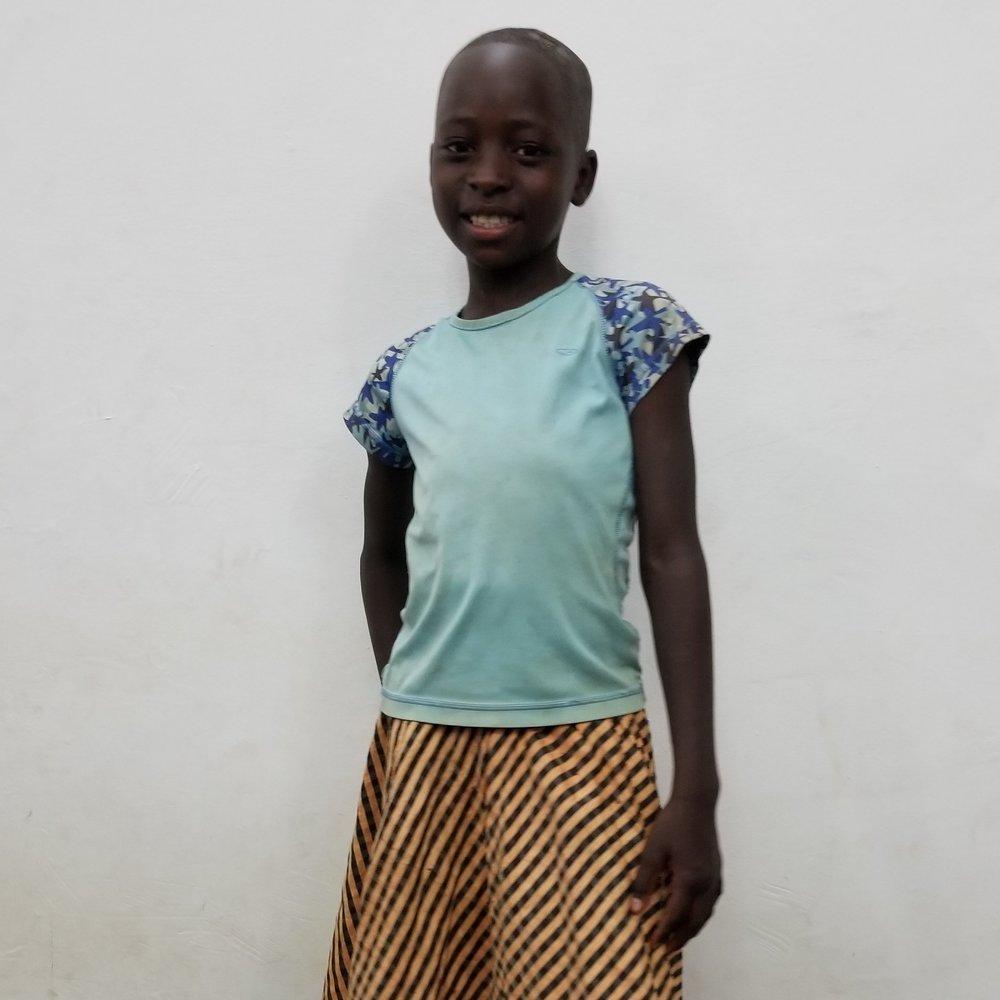 Johari Musa Masele   Age 8