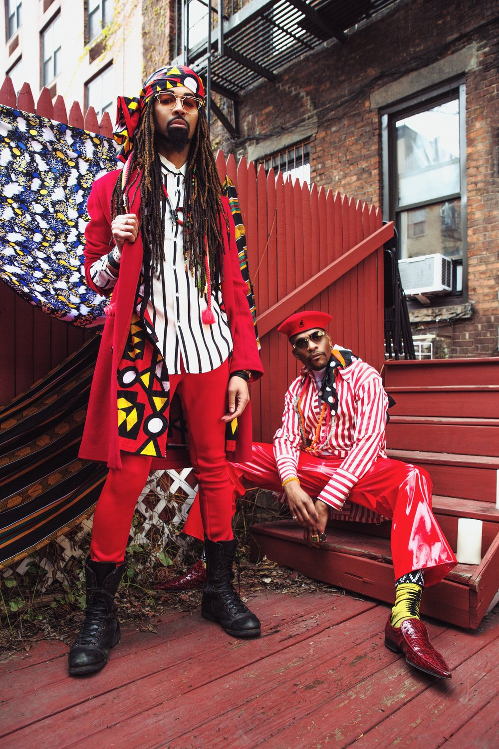 DapperAfrika &                   Ty Hunter - DapperAfrika is Fashion influencer in New York. Ty Hunter is Fashion Director and stylist.-DapperAfrika wears SS18 F.F.M.T. CHAEnewyork collection, Red & white stripe oversized shirts.