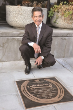 Hall of Fame jockey Laffit Pincay, Jr., shown with his Thoroughbred Racing Walk of Champions bronze plaque. Pincay is among nearly 70 outstanding horses, jockeys, trainers, owners and other key figures who have been honored.