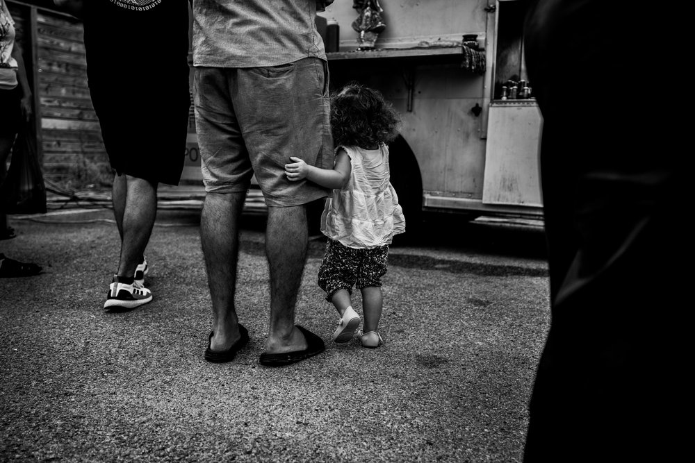 Little girl hugging her daddy's leg