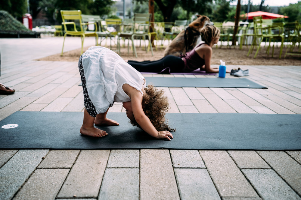 Little girl does yoga