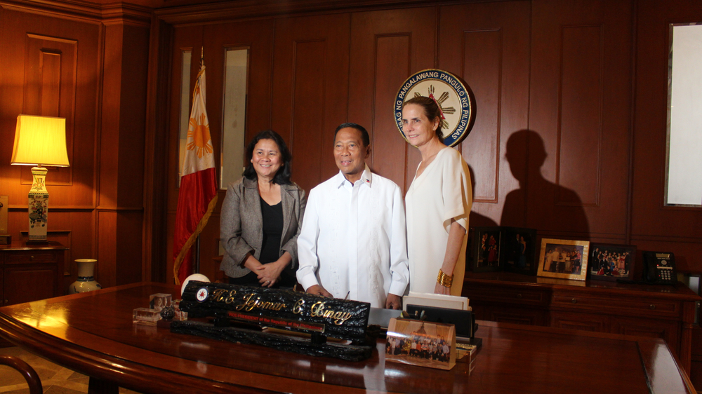 The founder of Freedom For All and Cecelia Oebanda of Visayan Forum are pictured with the  Vice President of The Philippines  (center).