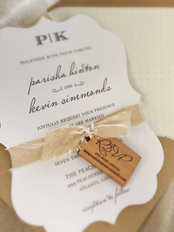 Dupioni silk ribbon and an engraved wood tag add rustic texture to a sweet die-cut invitation