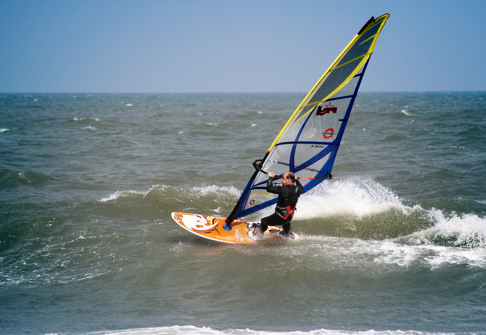 A Quebec man windsurfing on the oceanside of Canadian Hole in the Outer Banks, near Buxton, North Carolina, USA.