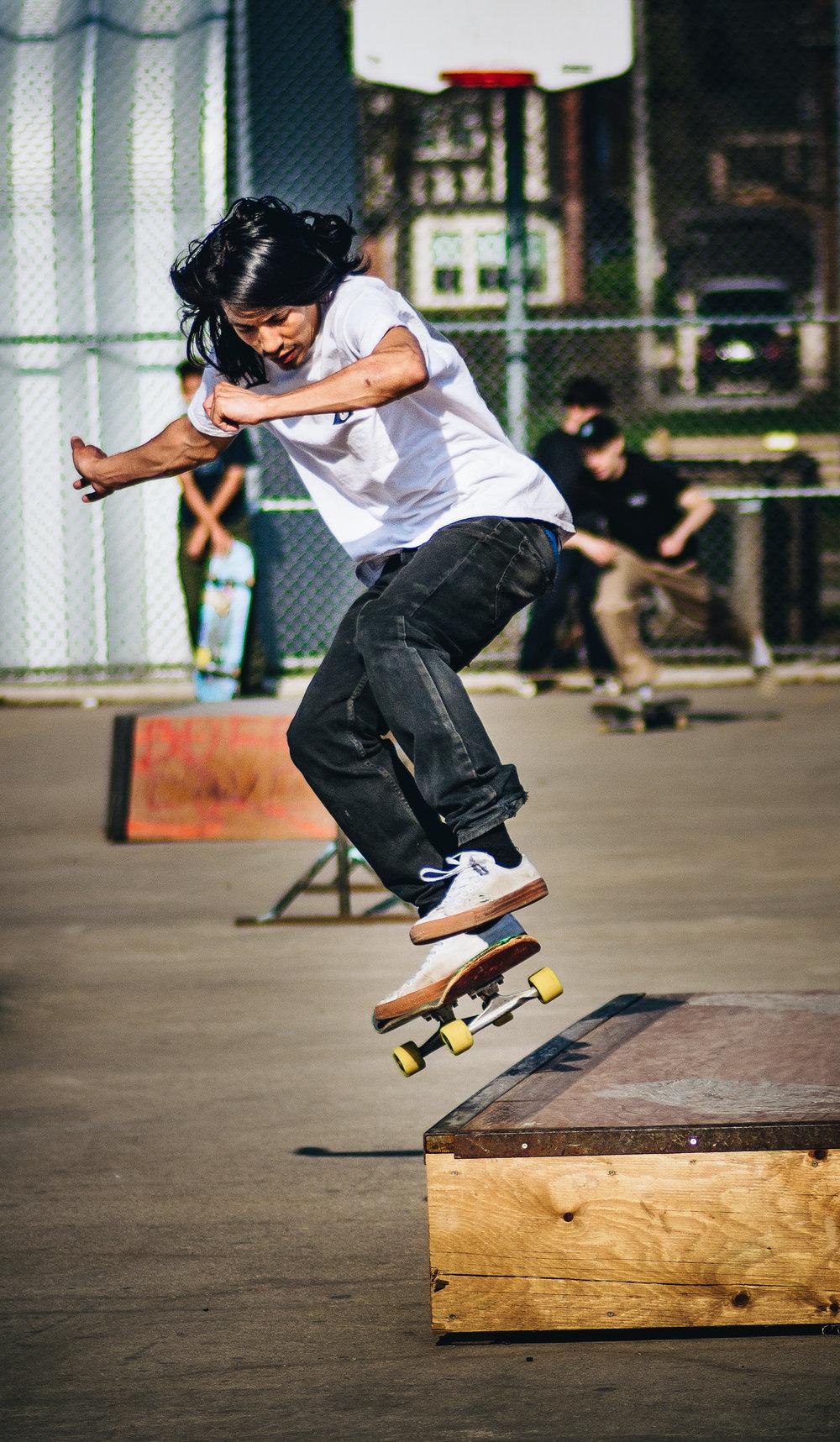 Skateboarding at Dufferin Grove skatepark, Toronto, 2017.