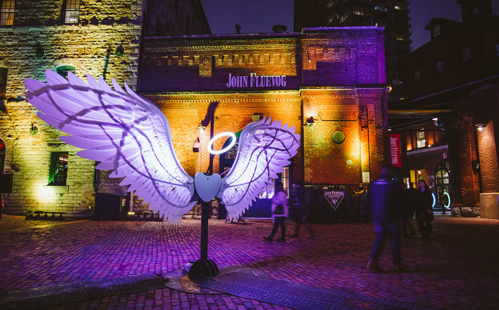 """Angels of Freedom"" by OGE Group, Israel. These were clearly the most popular installations of the festival, pretty much made for Instagram. And in return, for every person who posted a selfie here and tagged it #millstlights, the  Mill Street Brewery  donated a dollar to the Daily Bread Food Bank."