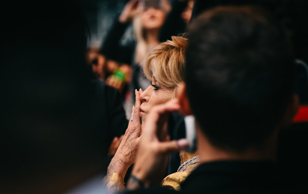 Jane Fonda blows kisses to her fans outside the Elgin & Wintergarden Theatre.