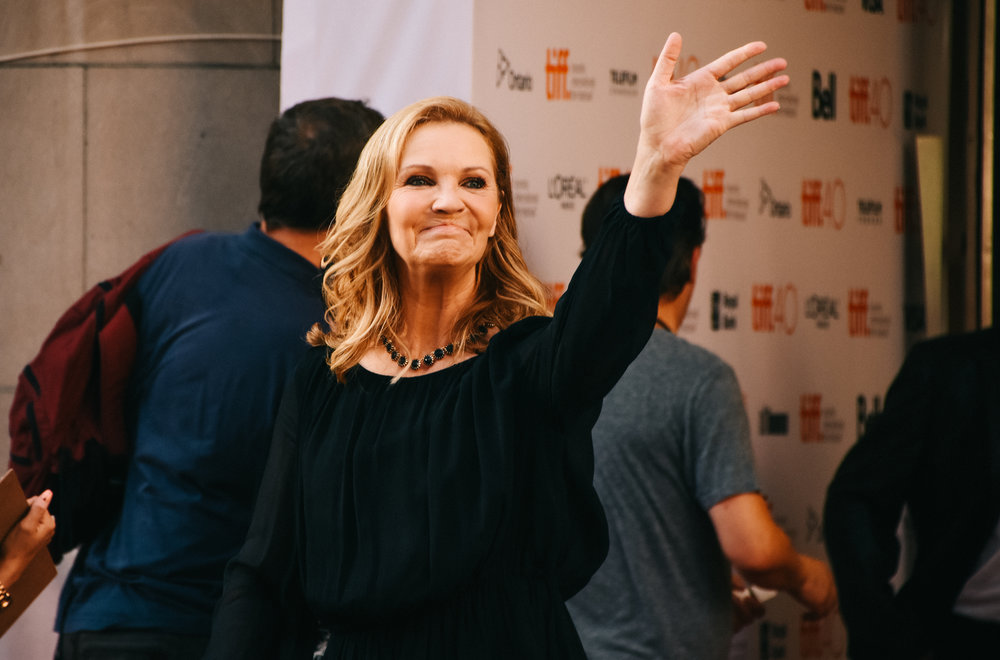 Joan Allen waves happily to the fans across King Street in front of Princess of Wales Theatre.