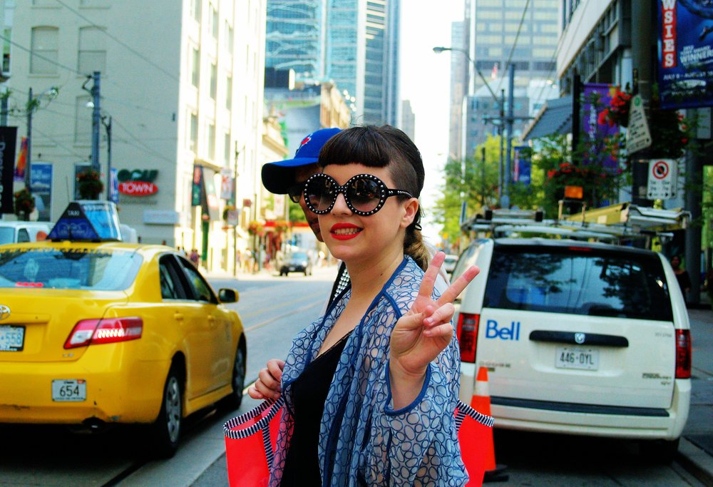 Italian-Canadian filmmaker and director Federica Foglia crosses the street downtown on the way to a photoshoot.