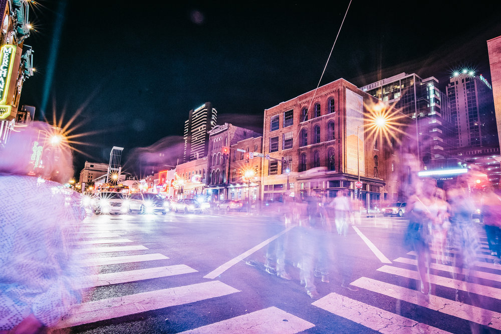 A long exposure of a busy corner on Broadway. If I had been set-up to take photos of people that night, there would be no shortage of drunk young people looking to have their pictures taken by any ole stranger at night.