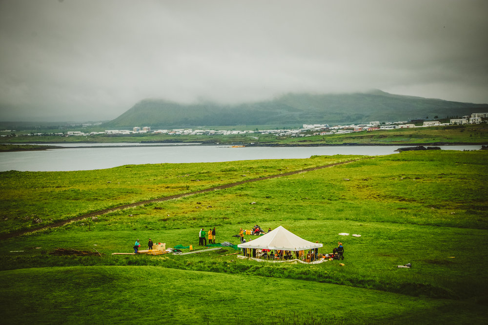 The students pack up the tents and campsite. In the distance you can see the east of the city and Mosfellsbær