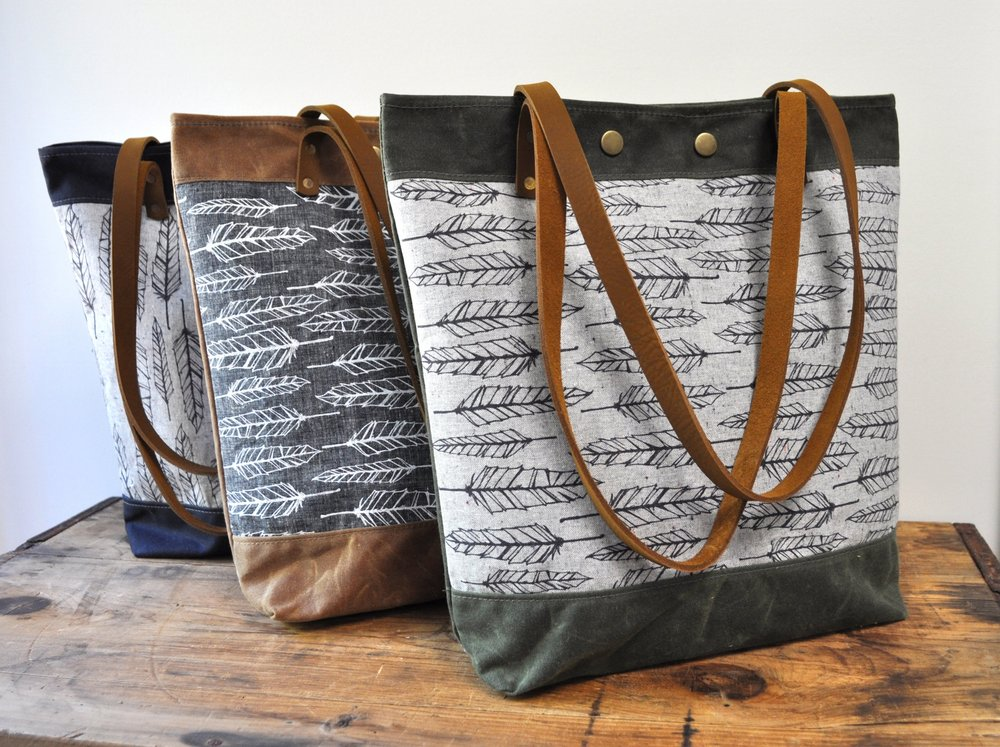 Waxed canvas tote bags with screen printed fabrics. Handmade in Vermont by Foliage Handbags.