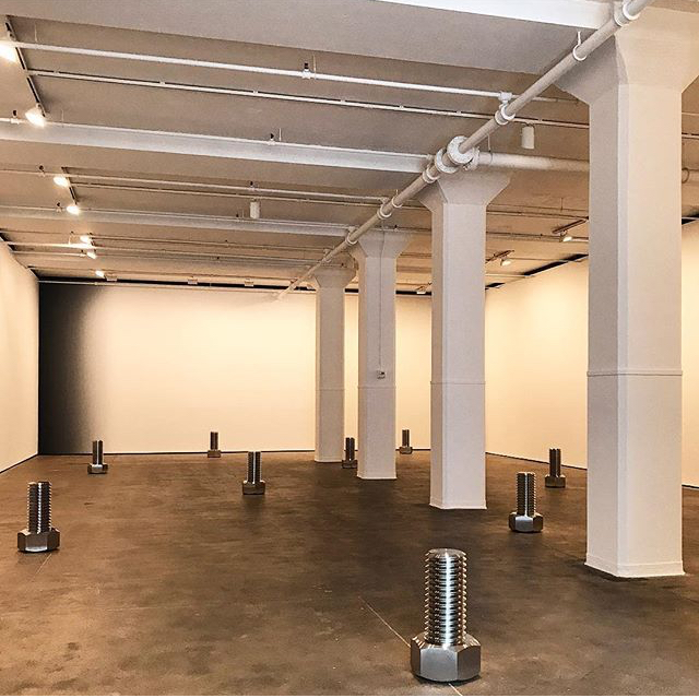 Ten pristine stainless steel sculptures based on specifications of standard industrial nuts and bolts at a scale of 1:20, each is two functional parts weighing 600 lbs total. Iran do Espírito Santo. From the exhibition, SHIFT at the Sean Kelly Gallery in New York.