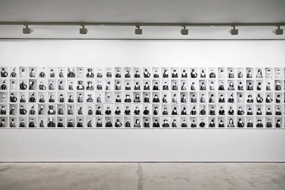 Untitled (165 portraits with dodgers), To Photograph The Details of A Dark Horse in Low Light, Installation View, Paradise Row, 2012 .jpg