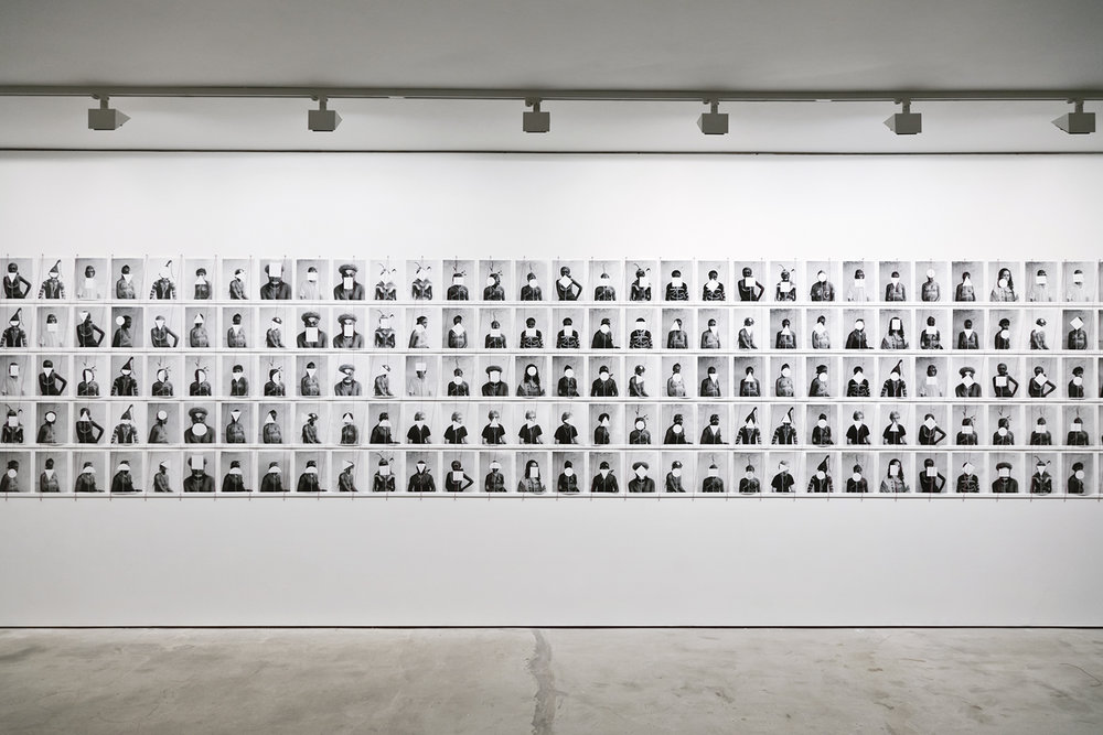 Untitled (165 portraits with dodgers), To Photograph The Details of A Dark Horse in Low Light, Installation View, Paradise Row, 2012