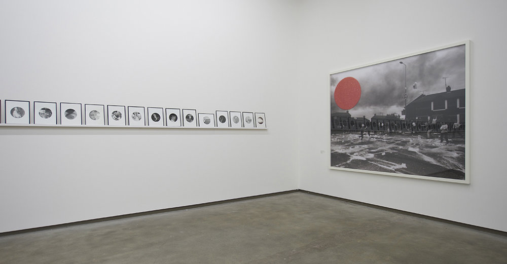 People in Trouble Laughing Pushed to the Ground (Dots), Installation View, Northern Ireland: 30 Years of Photography, Belfast Exposed, May 2013, image © Jordan Hutchings