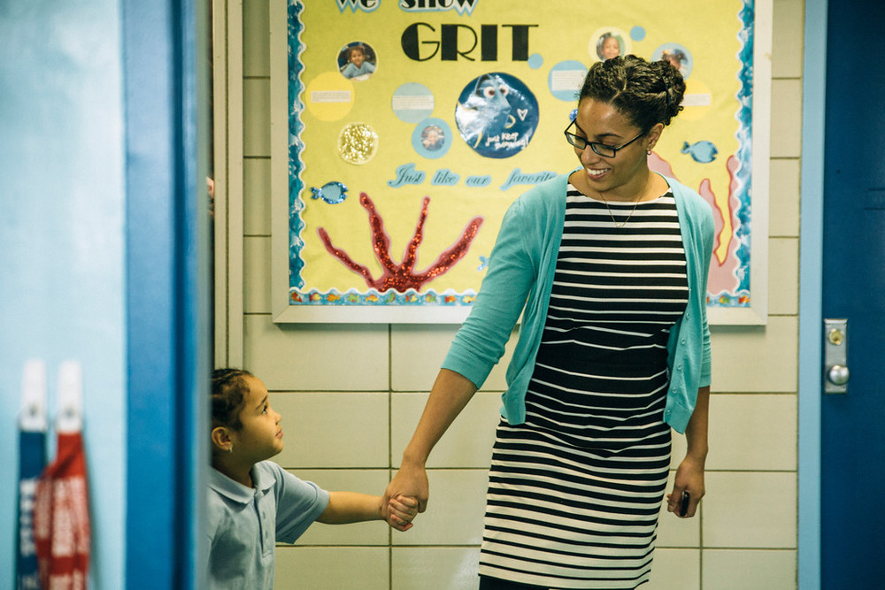 Injy Sullivan, principal of AF East New York Elementary, with a student.