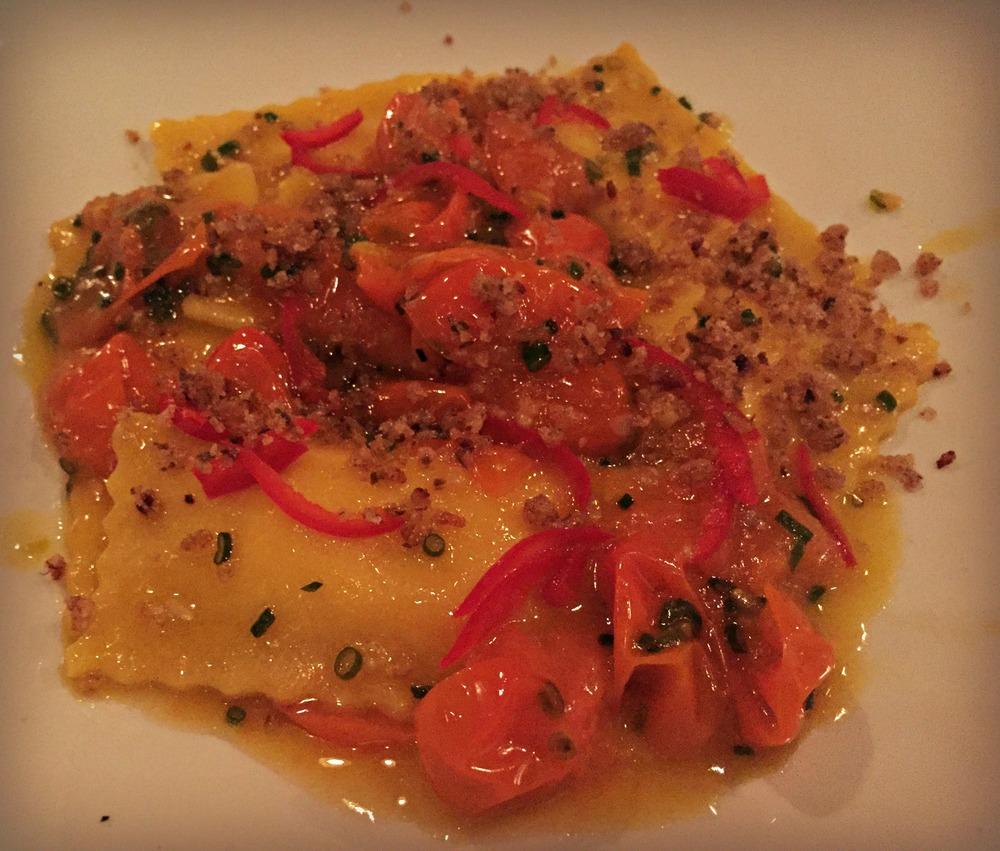 corn ravioli, fresno pepper, sungold tomato, caper breadcrumbs