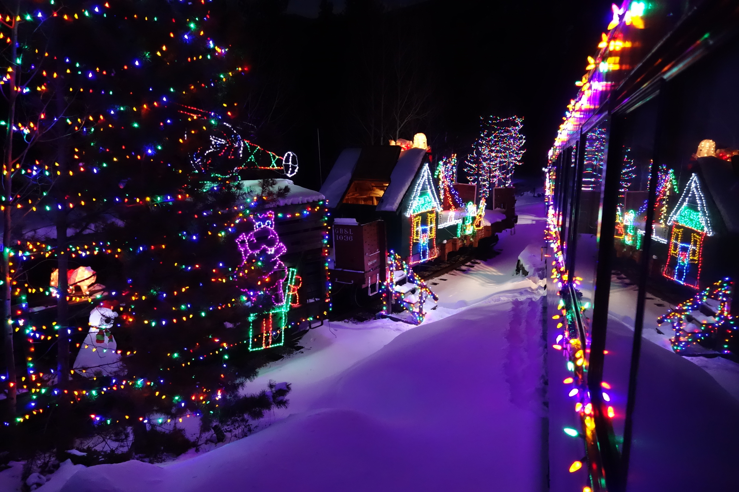 this stunning photo features the georgetown loop at night during the santas lighted forest train
