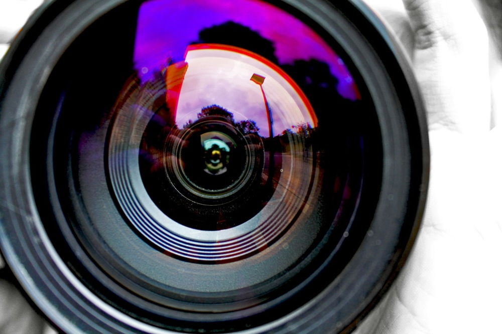 This photo of a camera lens invites the individual to take part in the Georgetown Loop photography trains, where passengers ride and then take a break to go out into the Rocky Mountains with a professional and shoot photos of the scenery and possibly wildlife.