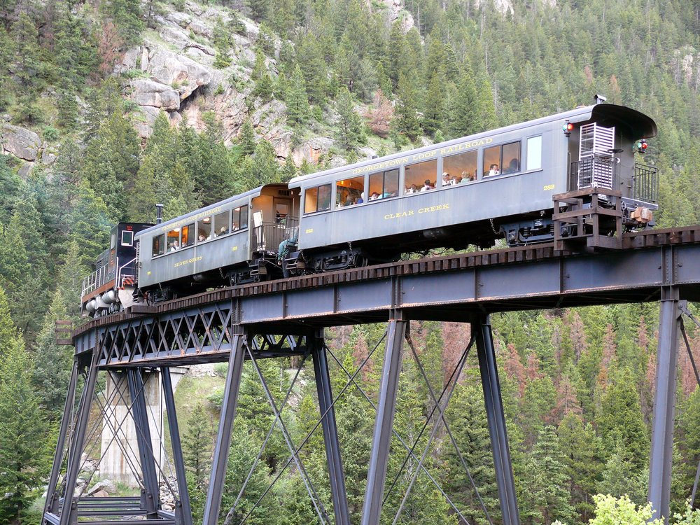 This is a photo of the first class White Pass parlor cars, on the Devil's Gate High Bridge, on the Georgetown Loop Railroad.