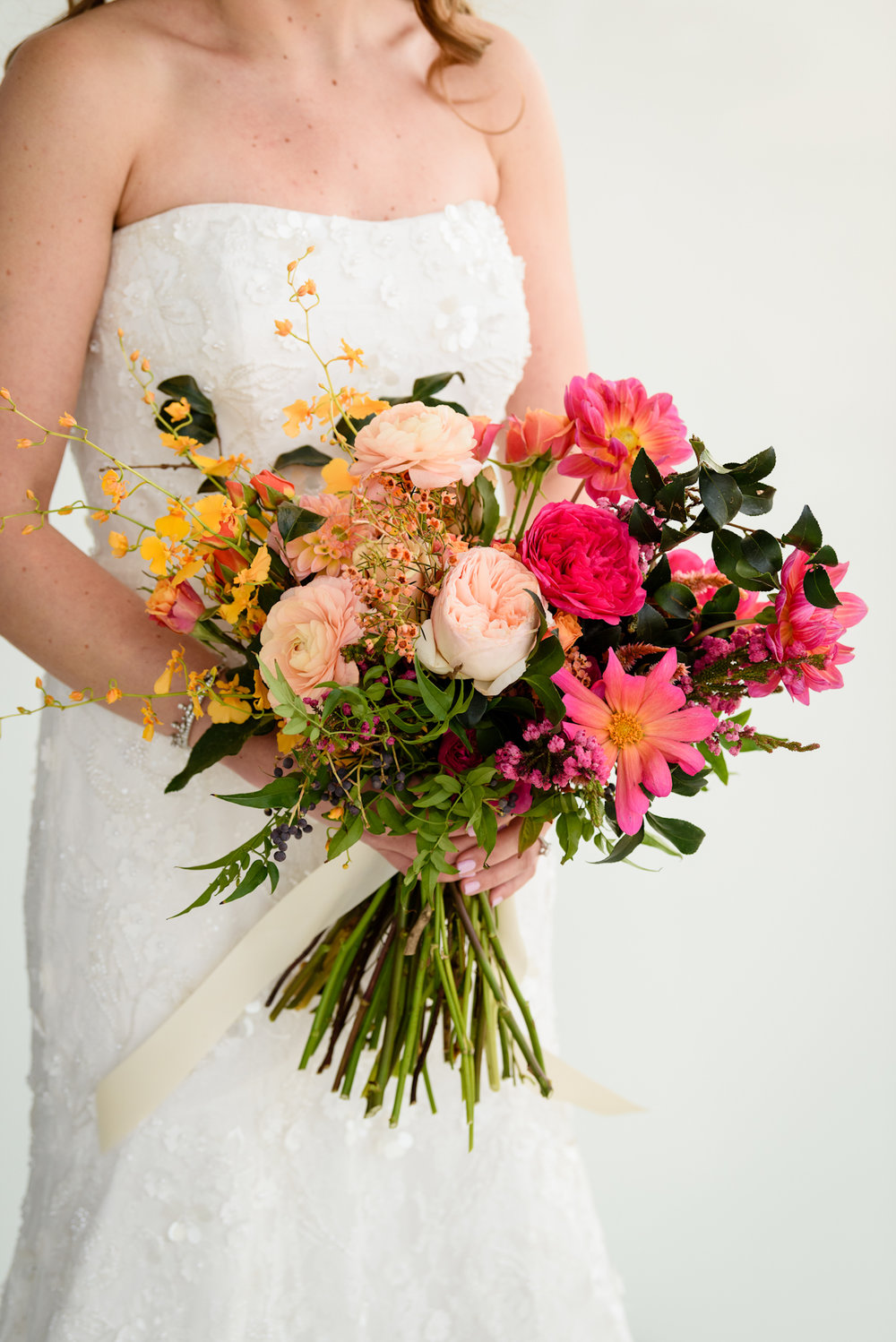 Pink, peach, yellow bouquet by Putnam and Putnam