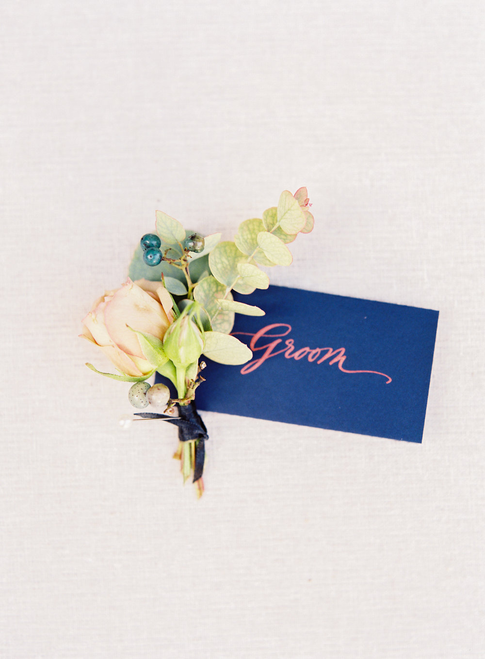Blue Hill at Stone Barns wedding, event planner Ang Weddings and Events, photography Judy Pak, boutonniere Saipua, navy calligraphy on place card