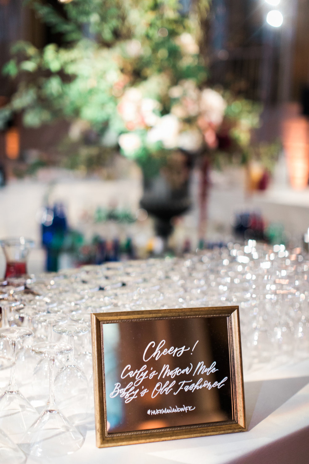 Cocktail sign with hand calligraphy on mirror at Plaza wedding