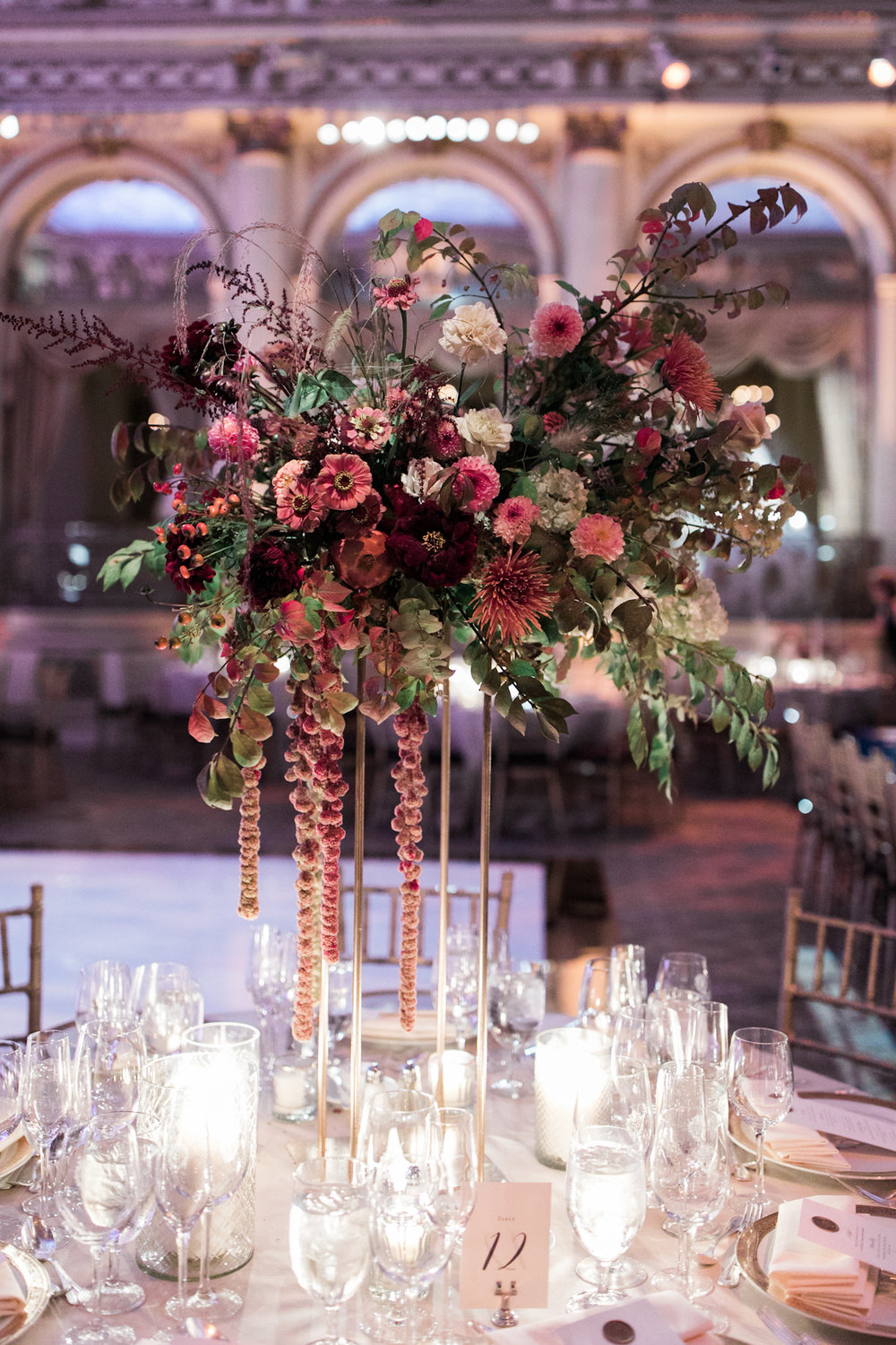 Plaza wedding tall floral centerpieces and candles