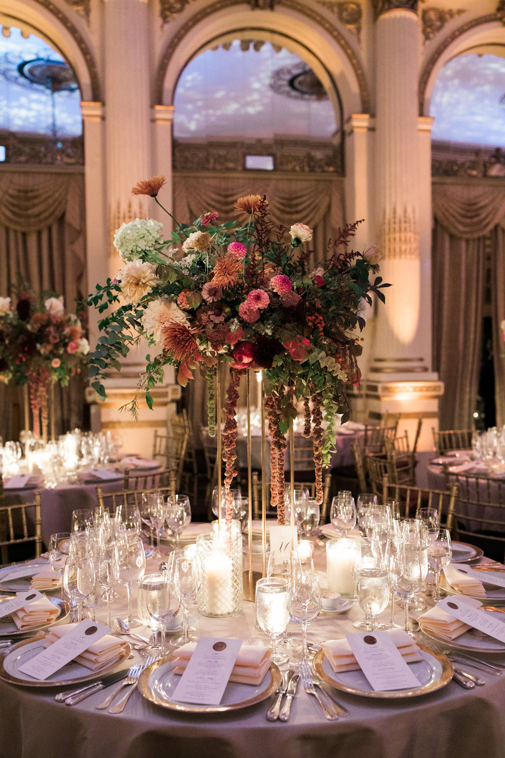 Plaza wedding tablescape with flowers, candles and chargers