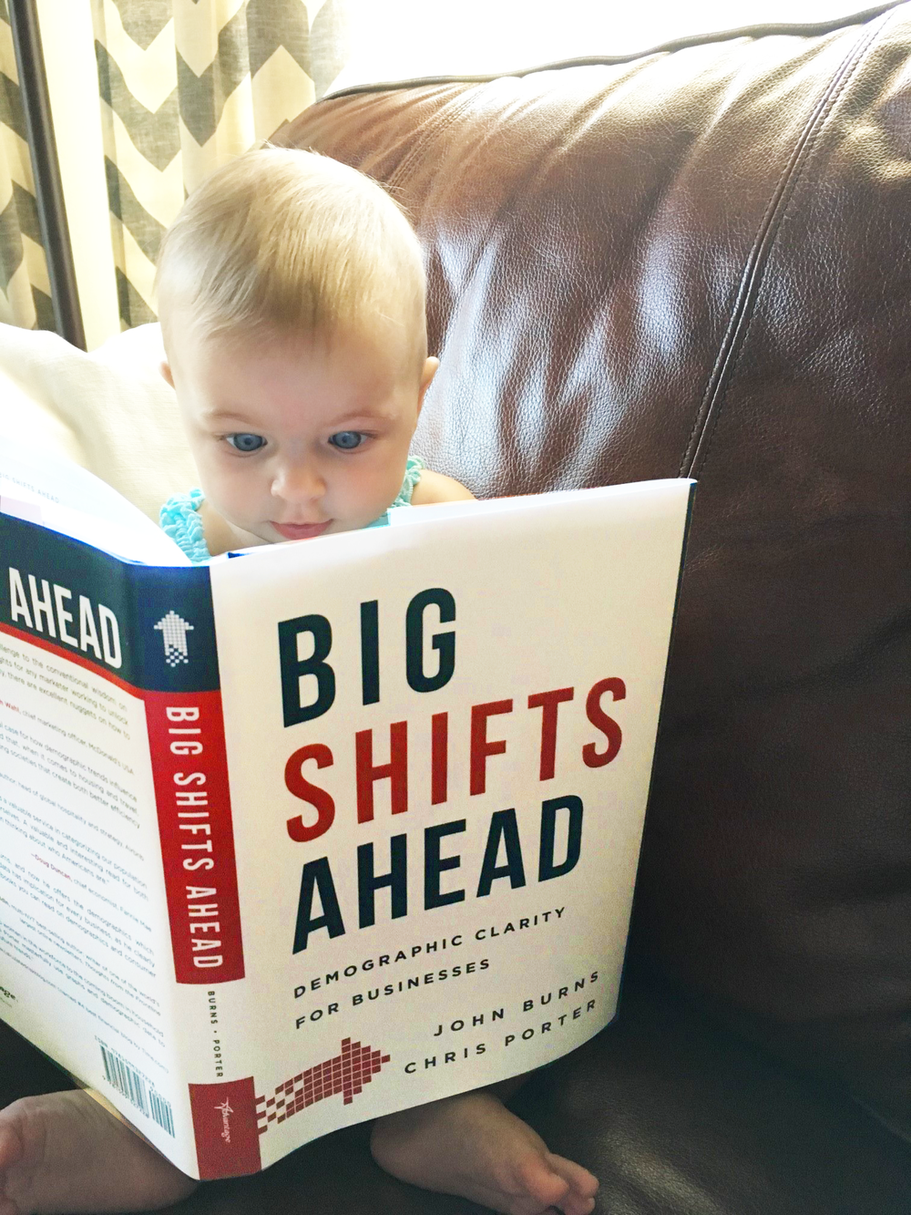 Our youngest reader, Finley Porter, supporting her dad (co-author Chris Porter), on launch day.