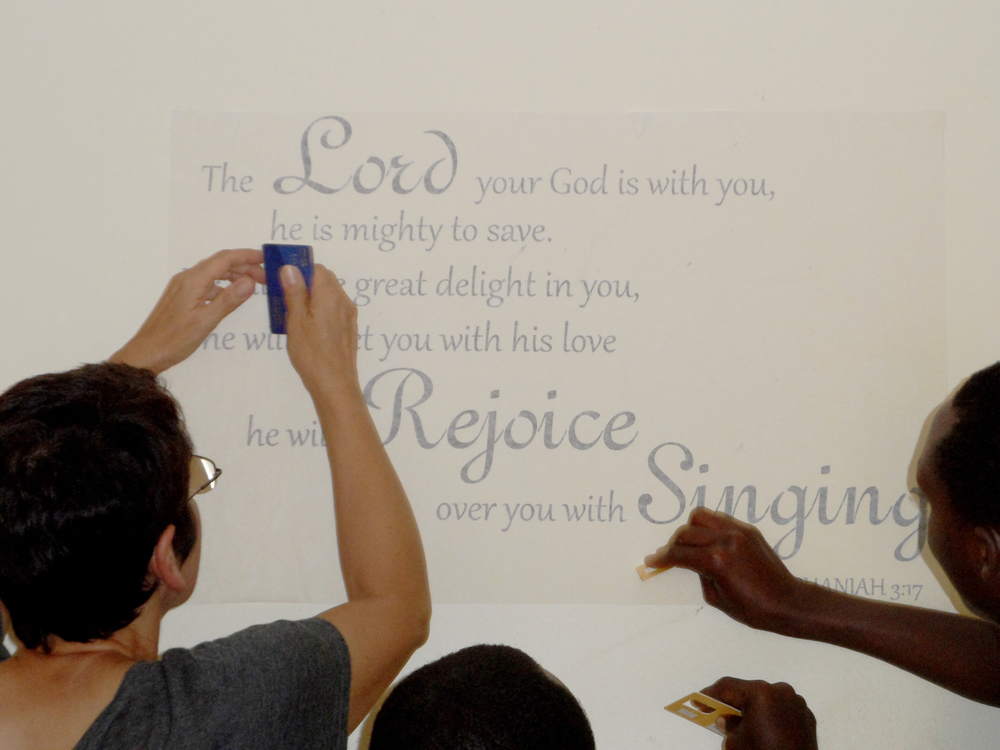 Cindy and JHR residents applying wall art