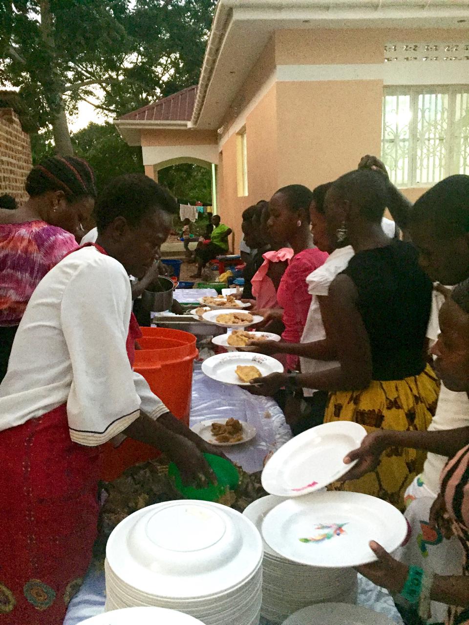 Bombo Pentacostal Church ladies serve the feast they prepared!