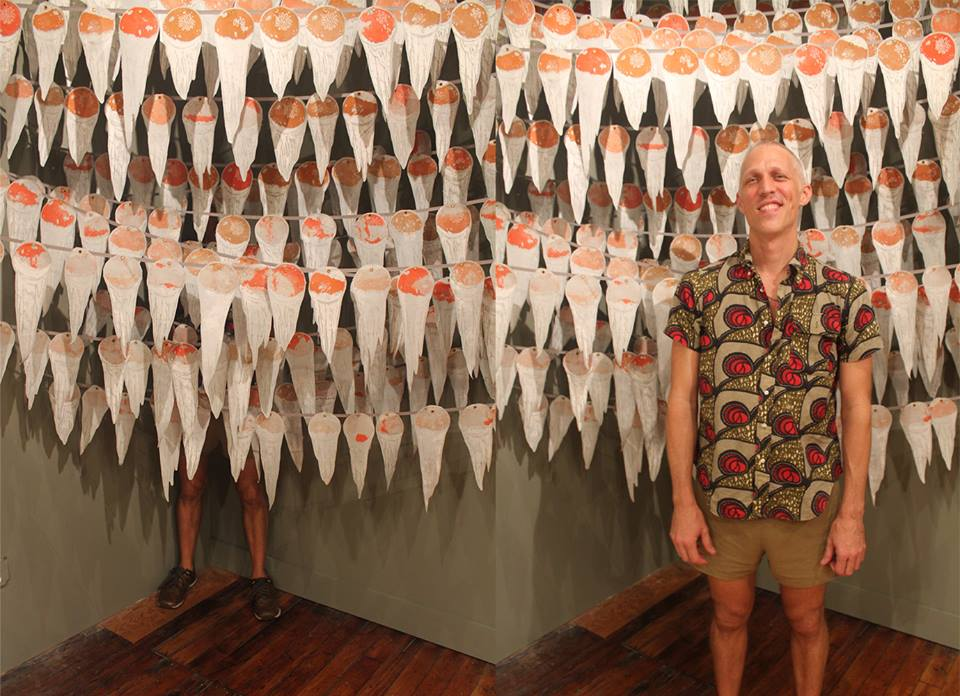 Our inaugural Artist-in-Residence, John Orth, in front of (and behind) his installation The Golden Age of Souvenirs..jpg