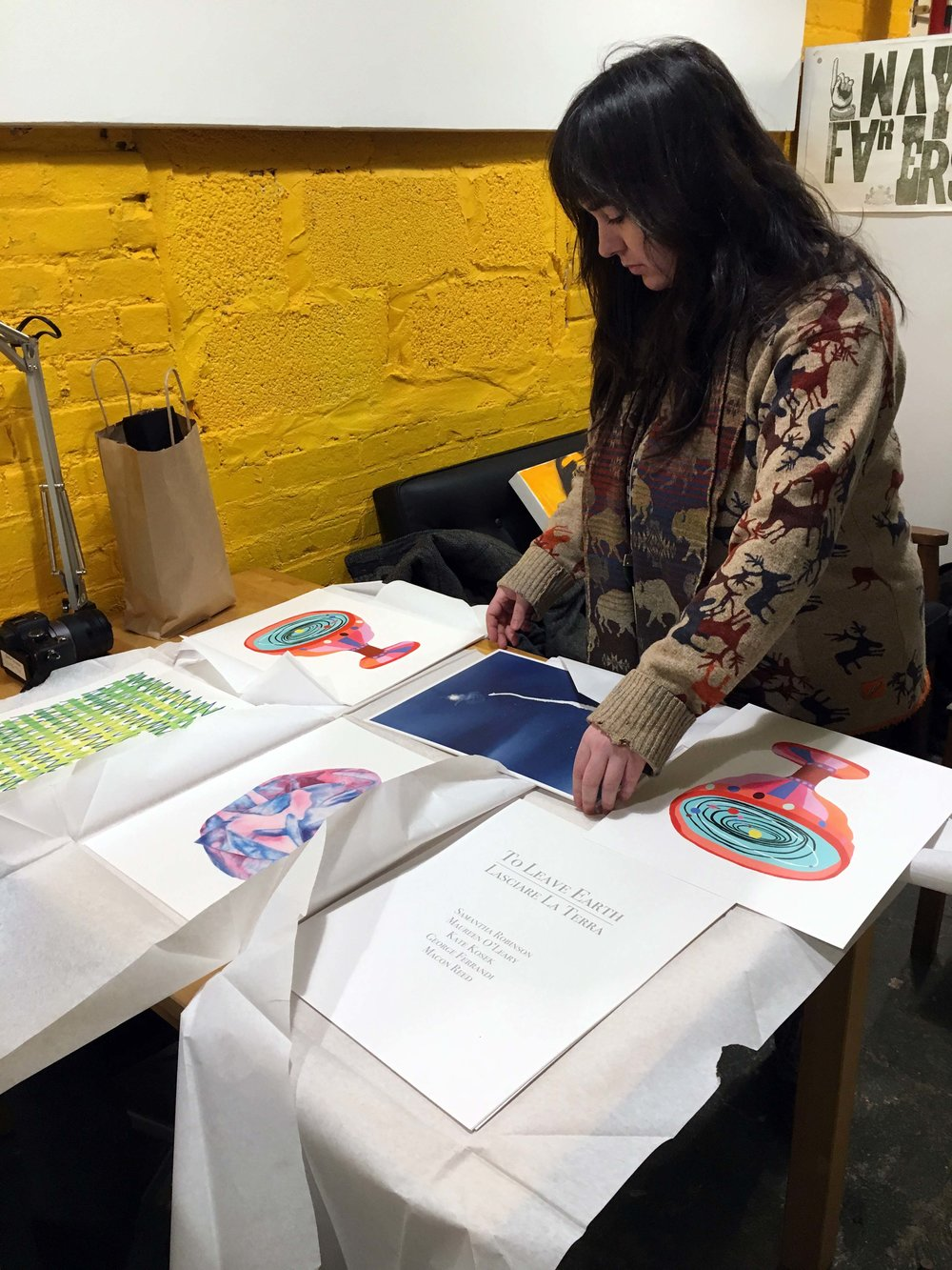Wayfarers member Samantha Robinson assembling the full portofolios at Wayfarers