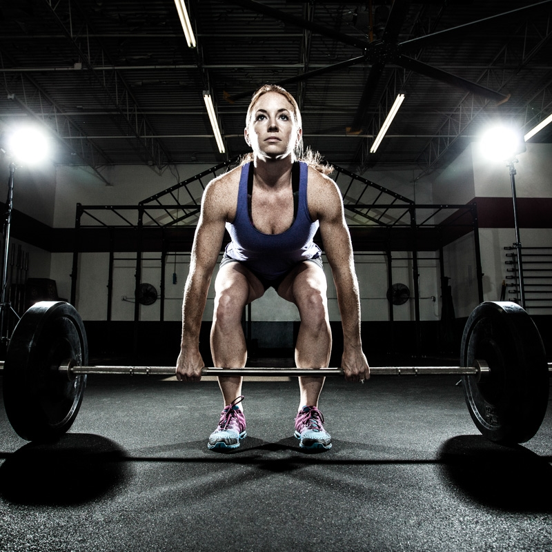 girl weight lifting after sports injury treatment